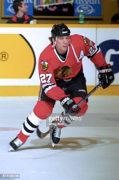 Jeremy Roenick of the Chicago Black Hawks skates against the Toronto Maple Leafs on January 24 1996 at Maple Leaf Gardens in Toronto Ontario Canada