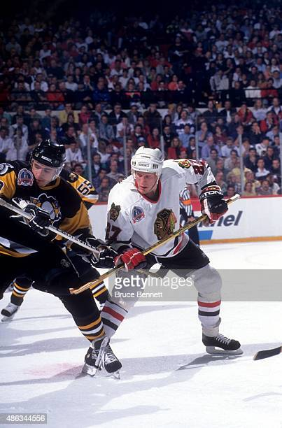 Jeremy Roenick of the Chicago Blackhawks and Ron Francis of the Pittsburgh Penguins tie eachother up after the faceoff during Game 4 of the 1992...