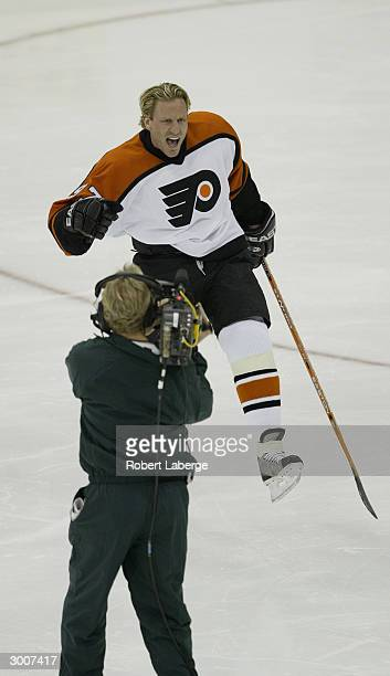 Jeremy Roenick of the Philadelphia Flyers celebrates during the NHL AllStar Super Skills Competition on February 7 2004 at the Xcel Energy Center in...