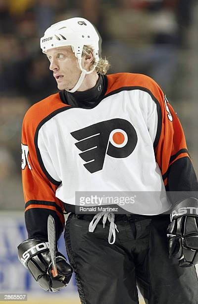 Jeremy Roenick of the Philadelphia Flyers looks on during a break in game action against the Dallas Stars at the American Airlines Center on December...
