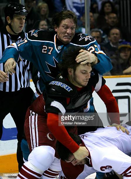Jeremy Roenick of the San Jose Sharks attempts to restrain Daniel Carcillo of the Phoenix Coyotes during the NHL game at HP Pavilion on December 20...