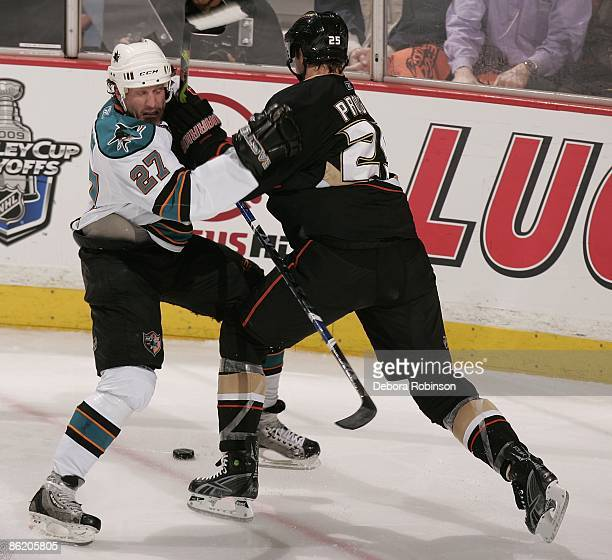 Jeremy Roenick of the San Jose Sharks gets a glove to the face from Chris Pronger of the Anaheim Ducks during Game Four of the Western Conference...
