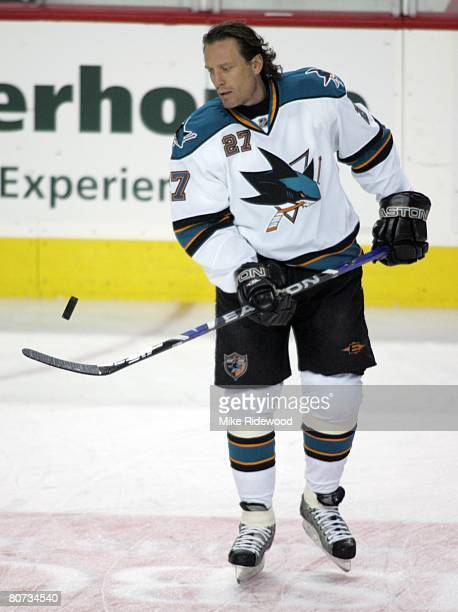 Jeremy Roenick of the San Jose Sharks juggles a puck on his stick before playing the Calgary Flames in game four of the Western Conference...