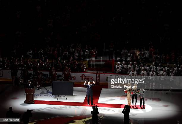 Jeremy Roenick waves to the crowd as he is inducted into the team's Ring of Honor before the NHL game between the Chicago Blackhawks and the Phoenix...