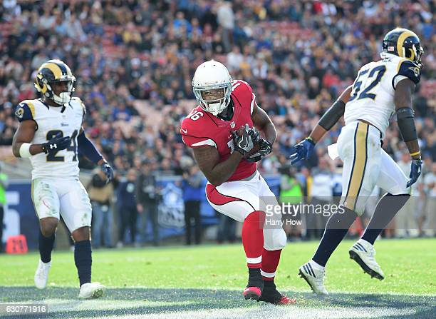 Jeremy Ross of the Arizona Cardinals makes a catch for a touchdown in front of Blake Countess and Alec Ogletree of the Los Angeles Rams to take a 130...