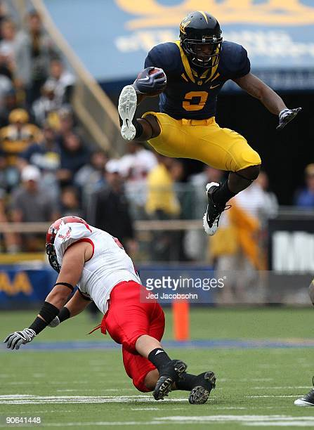 Jeremy Ross of the California Golden Bears jumps over Kyle Wilkins of the Eastern Washington Eagles on a punt return at Memorial Stadium on September...