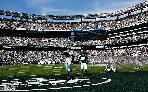Jeremy Ross of the Detroit Lions scores a 59-yard touchdown in the in the second quarter as Calvin Pryor of the New York Jets looks on at MetLife...