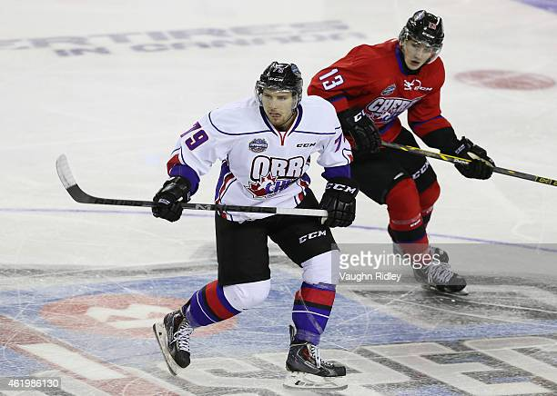 Jeremy Roy of Team Orr and Graham Knott of Team Cherry watch for the puck during the 2015 BMO CHL/NHL Top Prospects Game at the Meridian Centre on...
