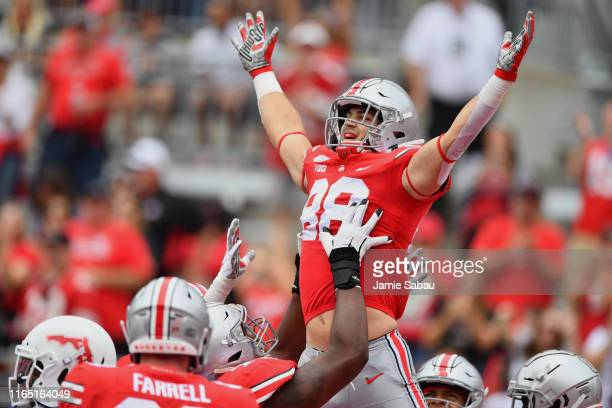 Jeremy Ruckert of the Ohio State Buckeyes celebrates after catching a 25-yard touchdown pass in the first quarter against the Florida Atlantic Owls...