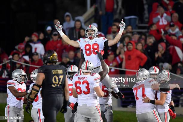 Jeremy Ruckert of the Ohio State Buckeyes celebrates with teammates after scoring a touchdown in the fourth quarter against the Northwestern Wildcats...