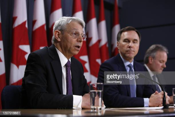 Jeremy Rudin, head of the Office of the Superintendent of Financial Institutions, left, speaks while Bill Morneau, Canada's minister of finance,...