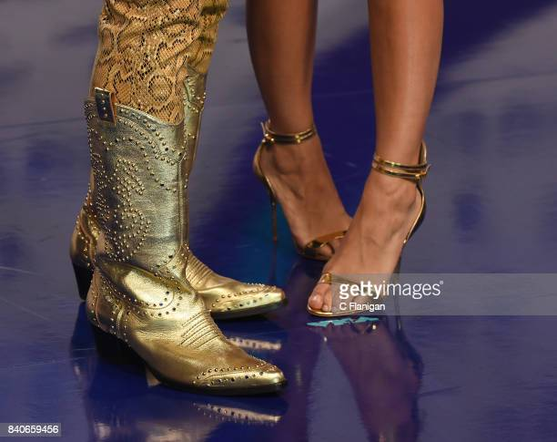 Jeremy Scott and Jasmine Sanders boot and shoe detail attend the 2017 MTV Video Music Awards at The Forum on August 27 2017 in Inglewood California