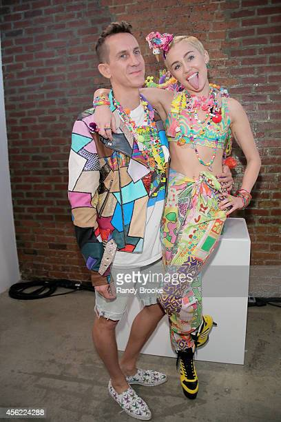 Jeremy Scott and Miley Cyrus backstage before the Jeremy Scott fashion show during MADE Fashion Week Spring 2015 at Milk Studios on September 10,...