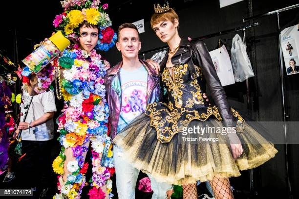 Jeremy Scott and models are seen backstage ahead of the Moschino show during Milan Fashion Week Spring/Summer 2018 on September 21 2017 in Milan Italy