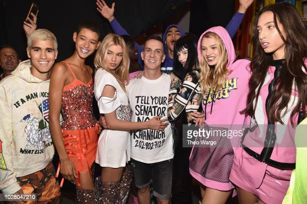 Jeremy Scott poses with models backstage for the Jeremy Scott show during New York Fashion Week The Shows at Gallery I at Spring Studios on September...