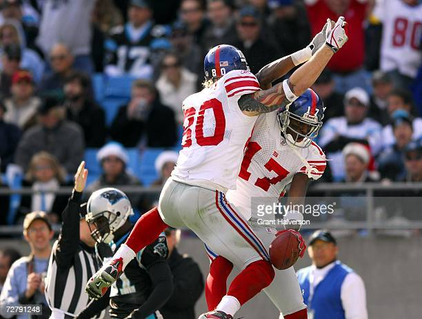 Jeremy Shockey and Plaxico Burress of the New York Giants celebrate Burress' touchdown against the Carolina Panthers on December 10 2006 at Bank of...