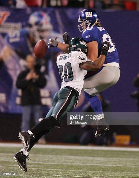 Jeremy Shockey of the New York Giants can't come up with a reception as Brian Dawkins of the Philadelphia Eagles defends on December 17 2006 at...