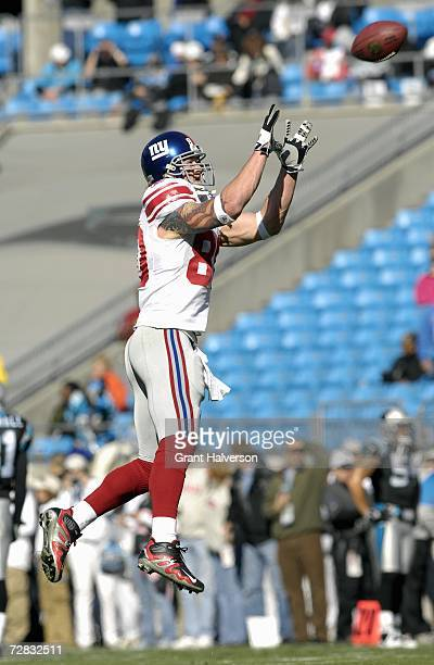 Jeremy Shockey of the New York Giants leaps for the catch before the game against the Carolina Panthers on December 10 at Bank of America Stadium in...