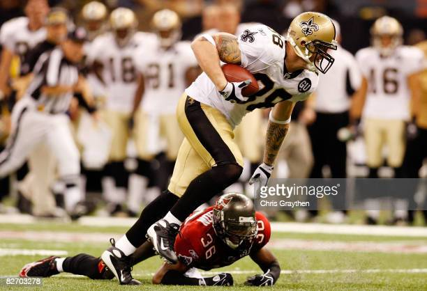 Jeremy Shockey the New Orleans Saints avoids a tackle by Tanard Jackson of the Tampa Bay Buccaneers at the Superdome September 7 2008 in New Orleans...