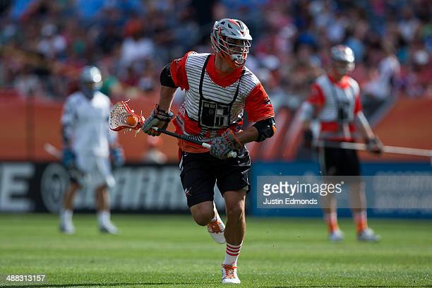Jeremy Sieverts of the Denver Outlaws in action against the Ohio Machine at Sports Authority Field at Mile High on May 4 2014 in Denver Colorado The...