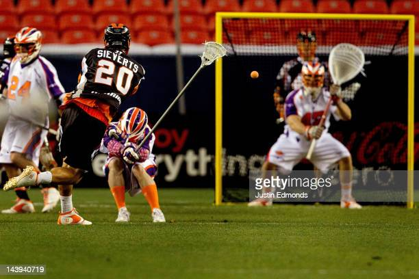 Jeremy Sieverts of the Denver Outlaws scores a twopoint goal against goalie Scott Rodgers of the Hamilton Nationals during the first half at Sports...