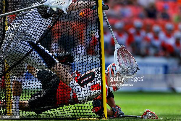 Jeremy Sieverts of the Denver Outlaws scores the game winning goal against Scott Rodgers of the Ohio Machine during the fourth quarter at Sports...
