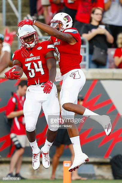 Jeremy Smith and Jaylen Smith of the Louisville Cardinals celebrate a touchdown against the Charlotte 49ersat Papa John's Cardinal Stadium on...