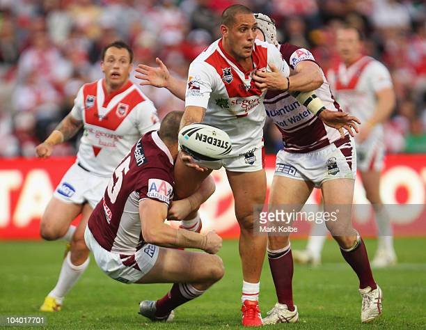 Jeremy Smith of the Dragons gets a pass away as he is tackled during the NRL Fourth Qualifying Final match between the St George Illawarra Dragons...