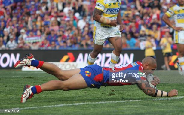 Jeremy Smith of the Knights scores a try during the round 26 NRL match between the Newcastle Knights and the Parramatta Eels at Hunter Stadium on...