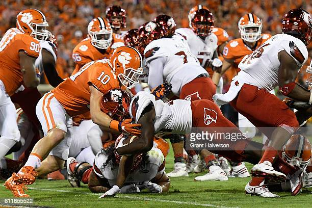 Jeremy Smith of the Louisville Cardinals dives past Ben Boulware of the Clemson Tigers for a second quarter touchdown at Memorial Stadium on October...