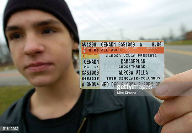 Jeremy Spencer displays his Damageplan concert ticket stub outside the Alrosa Villa nightclub the day after a gunman fired on the band Damageplan,...