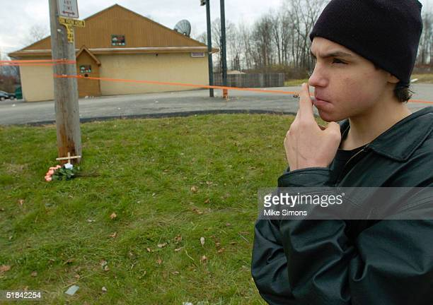 Jeremy Spencer smokes a cigarette outside the Alrosa Villa nightclub the day after a gunman fired on the band Damageplan, December 9, 2004 in...