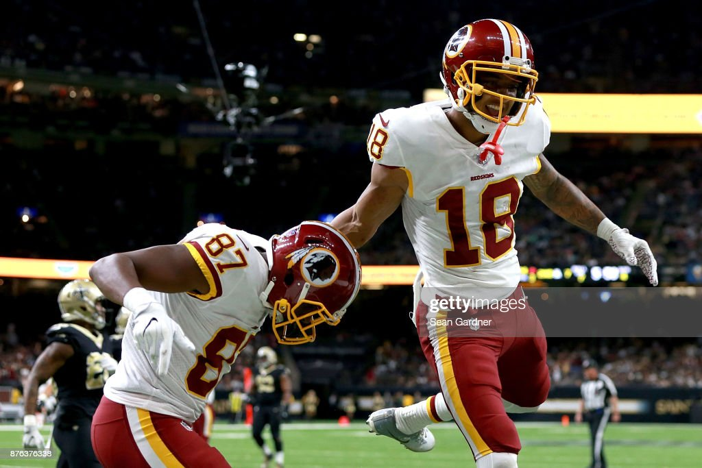 Jeremy Sprinkle #87 of the Washington Redskins celebrates with Josh Doctson #18 of the Washington Redskins after scoring a touchdown during the second half against the New Orleans Saints at the Mercedes-Benz Superdome on November 19, 2017 in New Orleans, Louisiana.
