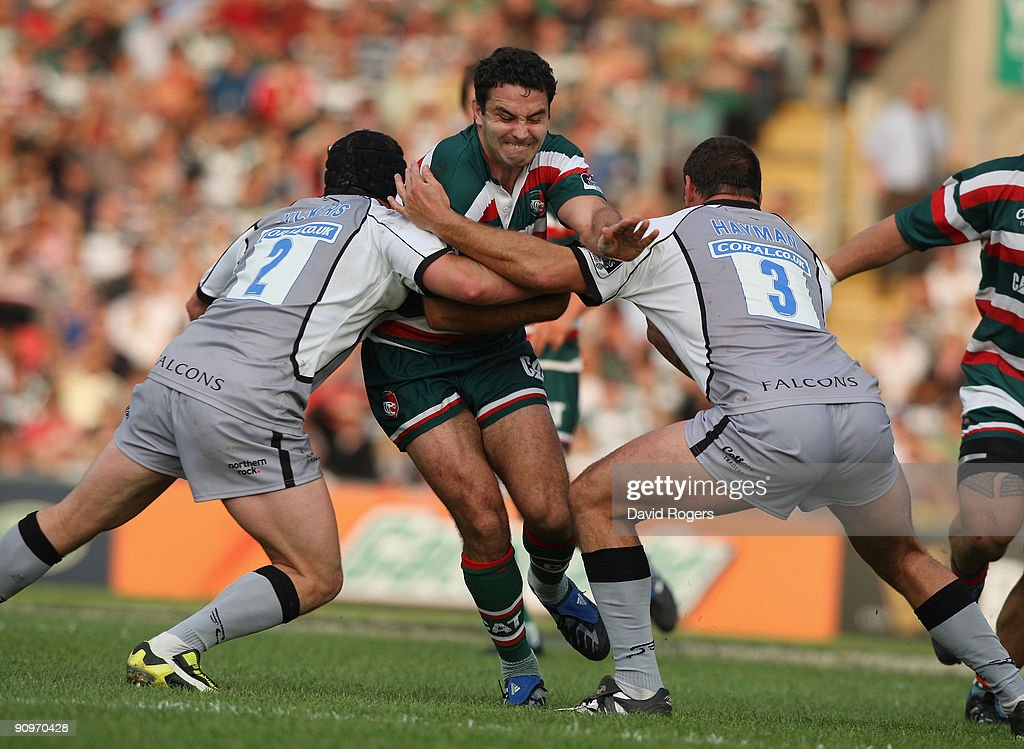 Jeremy Staunton of Leicester is tackled by Rob Vickers (L) and Carl Hayman during the Guinness Premiership match between Leicester Tigers and Newcastle Falcons at Welford Road on September 19, 2009 in Leicester, England.