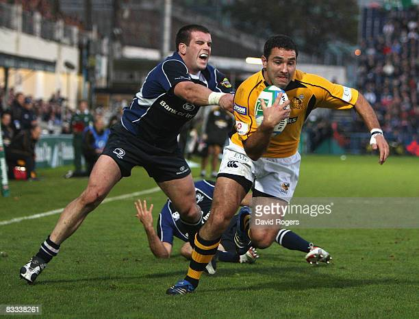 Jeremy Staunton the Wasps fullback races away from Shane Jennings to score a try during the Heineken Cup match between Leinster and London Wasps at...