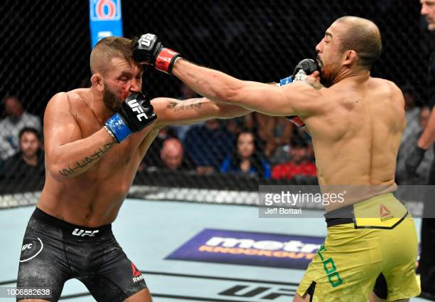 Jeremy Stephens and Jose Aldo of Brazil trade punches in their featherweight bout during the UFC Fight Night event at Scotiabank Saddledome on July...