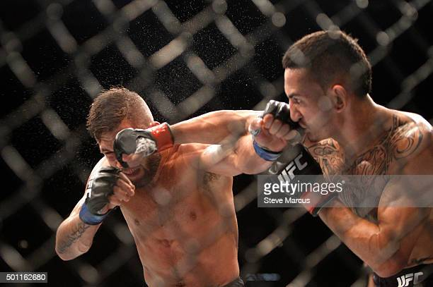 Jeremy Stephens and Max Holloway exchange blows in a featherweight fight during UFC 194 on December 12 2015 in Las Vegas Nevada