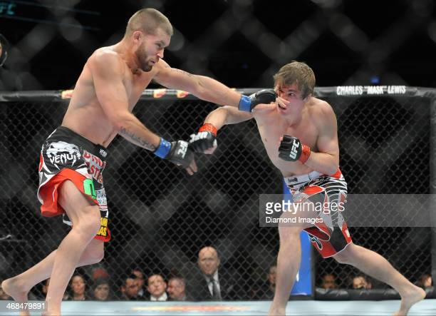 Jeremy Stephens attempts to dodge a punch from Darren Elkins during a featherweight bout during UFC on Fox 10 Henderson v Thomson at United Center in...