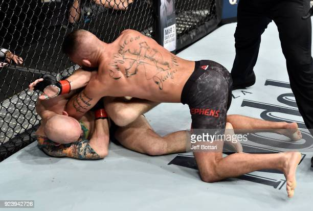 Jeremy Stephens elbows Josh Emmett in their featherweight bout during the UFC Fight Night event at Amway Center on February 24 2018 in Orlando Florida