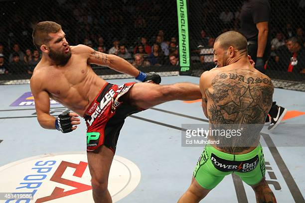 Jeremy Stephens kicks Cub Swanson in their featherweight bout at the ATT Center on June 28 2014 in San Antonio Texas