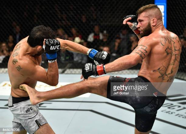Jeremy Stephens kicks Gilbert Melendez in their featherweight bout during the UFC 215 event inside the Rogers Place on September 9 2017 in Edmonton...