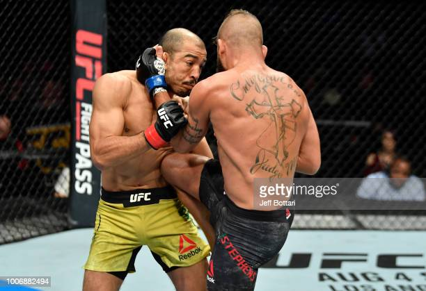 Jeremy Stephens knees Jose Aldo of Brazil in their featherweight bout during the UFC Fight Night event at Scotiabank Saddledome on July 28 2018 in...