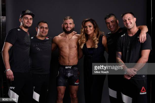 Jeremy Stephens poses for a post fight portrait backstage with his team during the UFC Fight Night event inside the Scottrade Center on January 14...