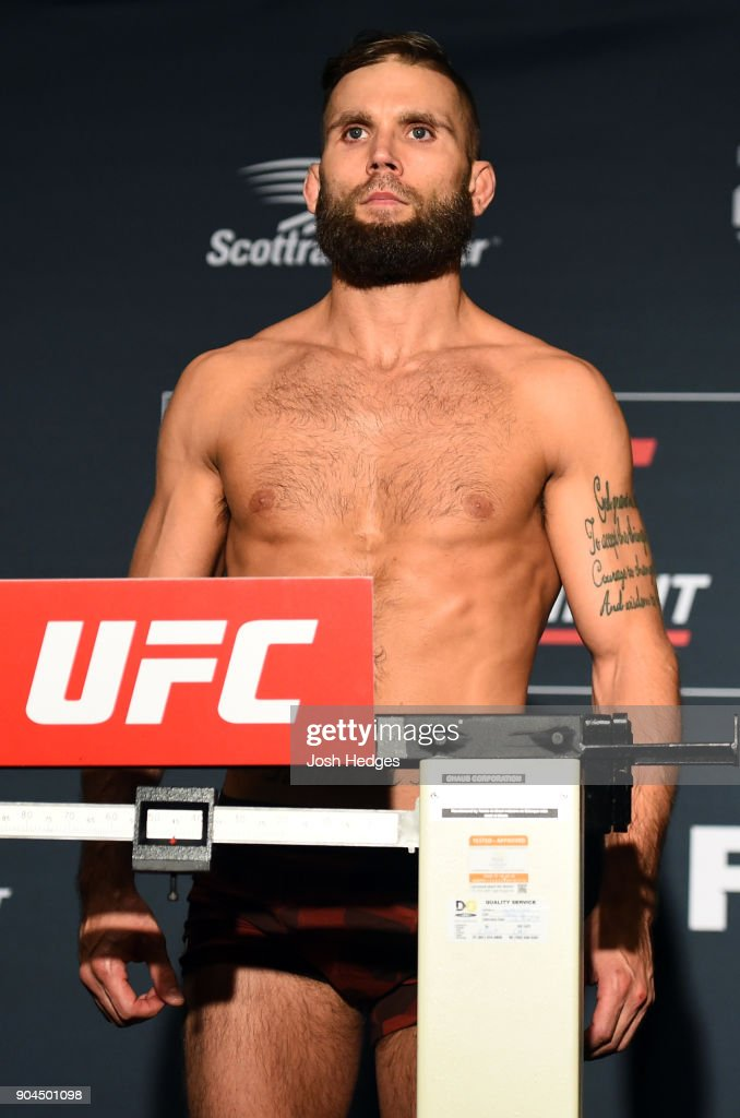 Jeremy Stephens poses on the scale during the UFC Fight Night weigh-in on January 13, 2018 in St. Louis, Missouri.