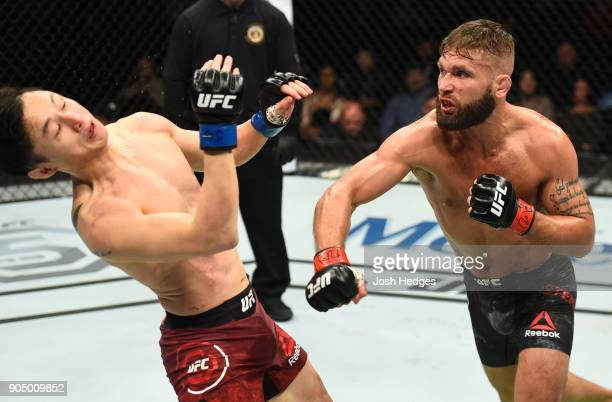 Jeremy Stephens punches Dooho Choi of South Korea in their featherweight bout during the UFC Fight Night event inside the Scottrade Center on January...
