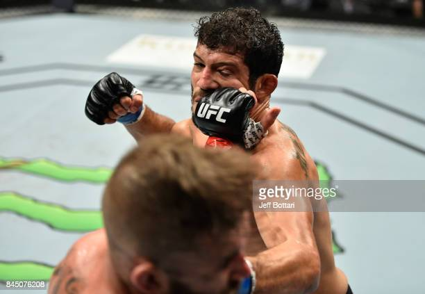 Jeremy Stephens punches Gilbert Melendez in their featherweight bout during the UFC 215 event inside the Rogers Place on September 9 2017 in Edmonton...