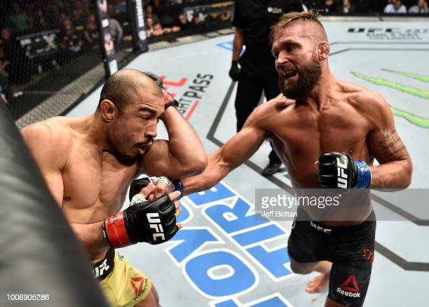 Jeremy Stephens punches Jose Aldo of Brazil in their featherweight bout during the UFC Fight Night event at Scotiabank Saddledome on July 28 2018 in...