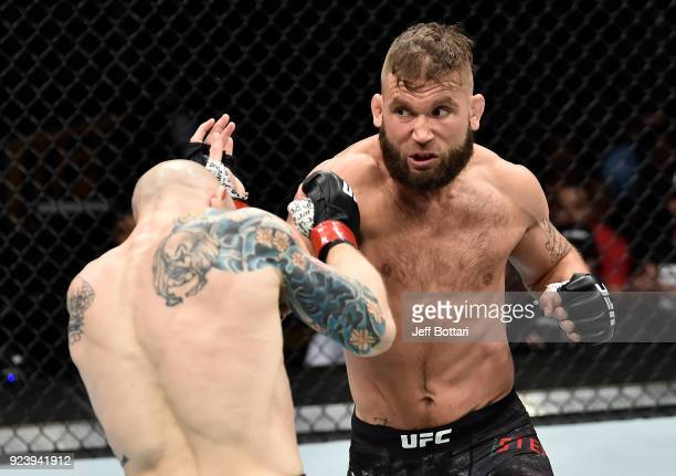 Jeremy Stephens punches Josh Emmett in their featherweight bout during the UFC Fight Night event at Amway Center on February 24 2018 in Orlando...
