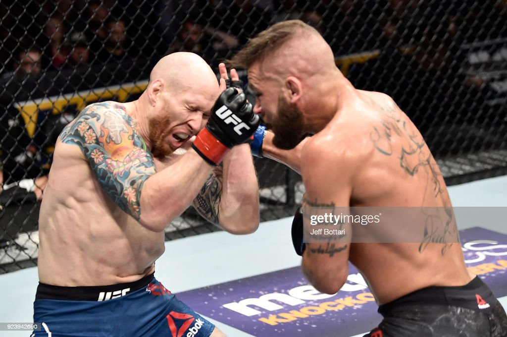 Jeremy Stephens punches Josh Emmett in their featherweight bout during the UFC Fight Night event at Amway Center on February 24, 2018 in Orlando, Florida.