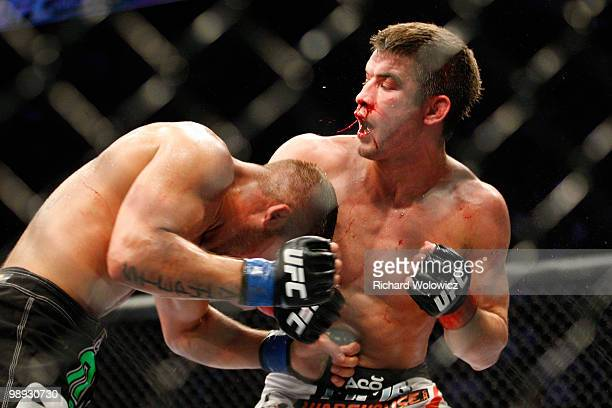 Jeremy Stephens punches Sam Stout in the stomach in their lightweight swing bout at UFC 113 at Bell Centre on May 8 2010 in Montreal Quebec Canada